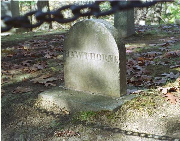 The headstone of 19th-century writer Nathaniel Hawthorne is seen Tuesday, Nov. 7, 2000, in Sleepy Hollow Cemetery in Concord, Mass. The little-known cemetery is also the final resting place of writers Henry David Thoreau, Louisa May Alcott and Ralph Waldo Emerson, in a section called authors ridge. (AP Photo/James Walker) Photo: JAMES WALKER, ASSOCIATED PRESS / AP2000