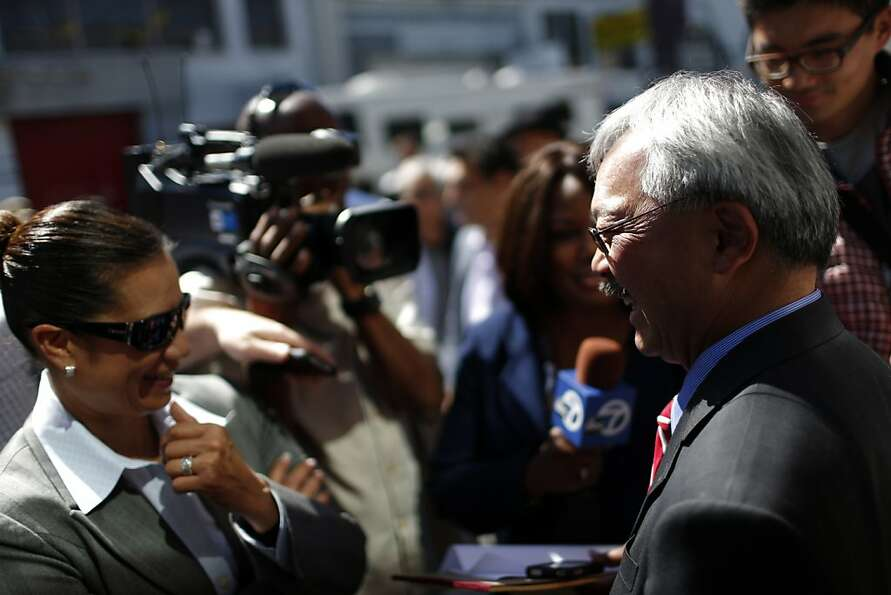 Mayor Ed Lee (right) is interviewed after speaking in support of Proposition E during a rally on