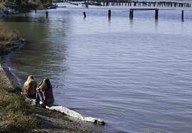 Park goers sit along the Carquinez Regional Shoreline on Friday, October 19, 2012.