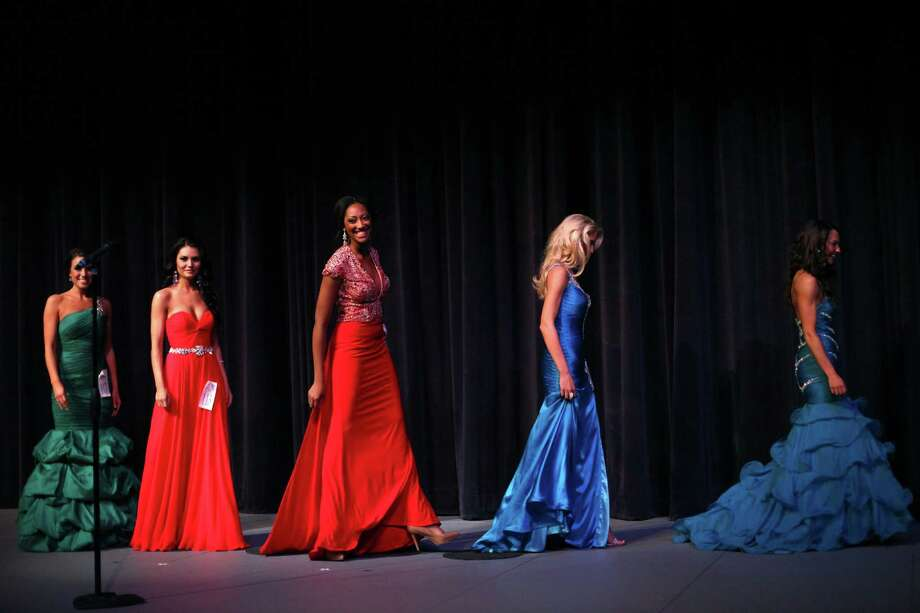 Contestants walk offstage during the Miss Washington USA and Miss Teen Washington USA pageant on Sunday at the Highline Performing Arts Center in Burien. Miss Washington was chosen at the event to represent the Evergreen State in the 2013 Miss USA pageant. Photo: JOSHUA TRUJILLO / SEATTLEPI.COM