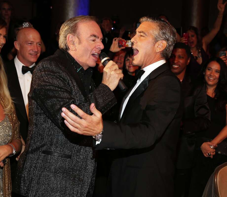Singer Neil Diamond (L) and actor George Clooney perform during the 26th Anniversary Carousel Of Hope Ball presented by Mercedes-Benz at The Beverly Hilton Hotel on October 20, 2012 in Beverly Hills, California. Photo: Christopher Polk, Getty Images / 2012 Getty Images