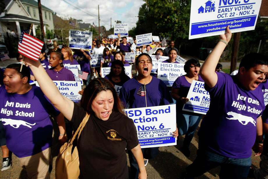 "Shouting ""vote,"" more than 300 Davis High School students, parents representing the high school and Marshall Middle School and community members paraded from Davis High School to the early voting location at nearby Holy Name Catholic Church Monday, Oct. 22, 2012, in Houston. 