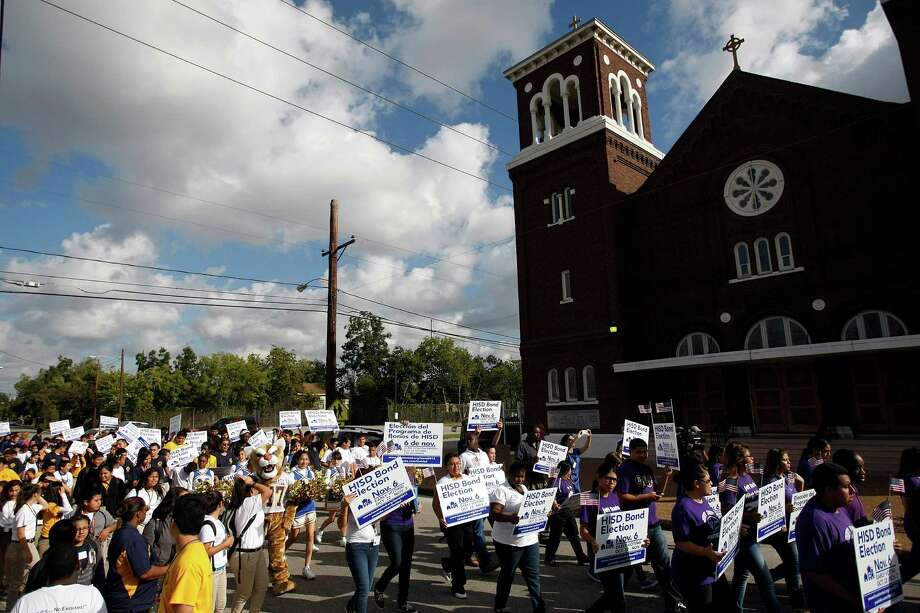 Jefferson Davis High School students, parents and others paraded to the early voting site at Holy Name Catholic Church Monday. See a gallery from the parade. Photo: Johnny Hanson, Houston Chronicle / © 2012  Houston Chronicle