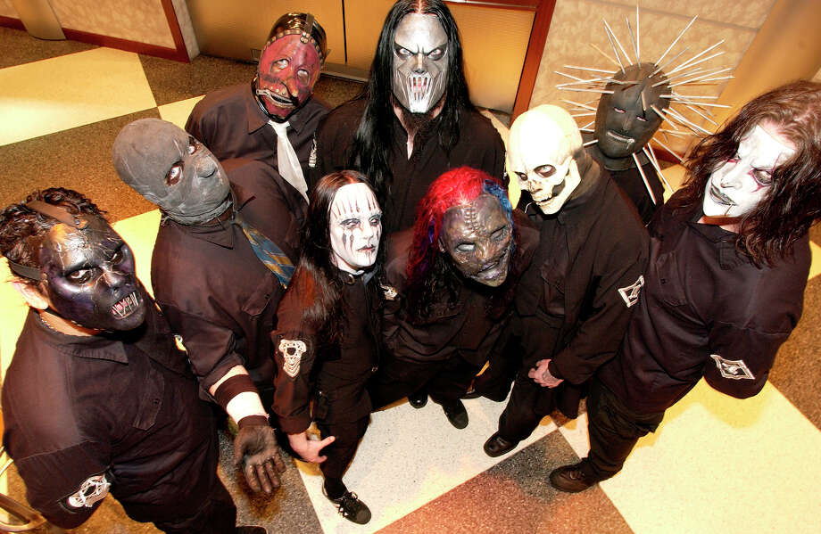 Metal band SlipKnot look like they could be an attraction inside a haunted house.  Photo: JIM COOPER, AP / AP