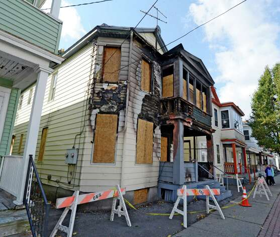 20 Benson Street in Albany, N.Y. shows the scars Oct 22, 2012 of last week's fire that claimed the life of a 3-year-old.      (Skip Dickstein/Times Union) Photo: Skip Dickstein