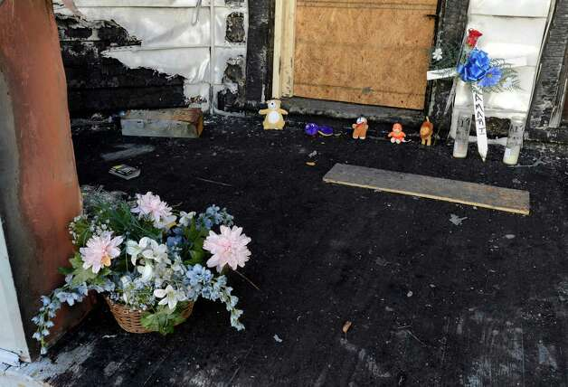 A small memorial at the front door of 20 Benson Street in Albany, N.Y. Oct 22, 2012, marks the scene of last week's fire that claimed the life of a 3-year-old.      (Skip Dickstein/Times Union) Photo: Skip Dickstein