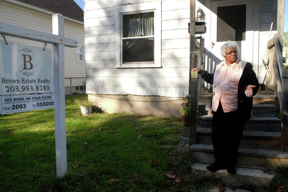 Doris Ganues stands outside her home in the South End of Stamford, Conn. on Monday October 22, 2012.  Ganues has tried for almost a year to get into a new affordable housing development in the South End. After about 8 months of waiting, Ganues, a 40-year resident of the South End, learned she did not qualify. According to her, the process is both unfair and too complex. Photo: Dru Nadler, Dru Nadler/For The Advocate / Stamford Advocate Freelance