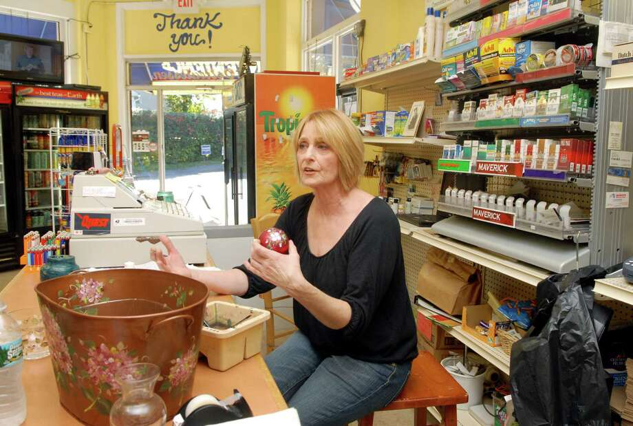 Maria Sileo hand paints objects for her buisness Cottage Borne during slow periods at the J & M Deli in Stamford, Conn. on Monday October 22, 2012 which she owns with her fiancee. Photo: Dru Nadler / Stamford Advocate Freelance