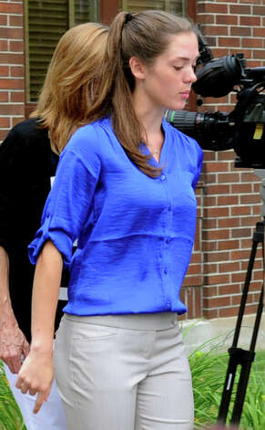 Brianna McEwan leaves the Norwalk Courthouse after a continuance was granted in her case on Friday, June 22, 2012. McEwan is facing negligent homicide charges in the death of Norwalk jogger Kenneth Dorsey this spring. Photo: Lindsay Niegelberg / Stamford Advocate