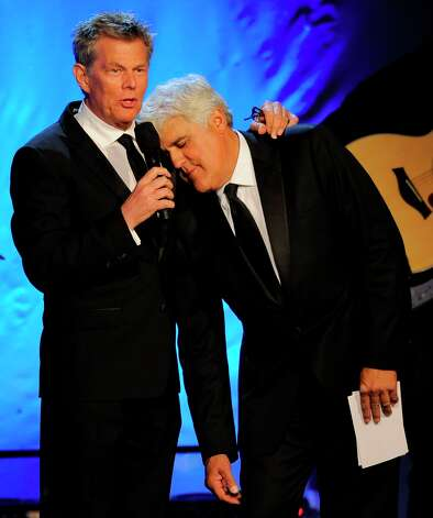 Music director David Foster, left, and host Jay Leno share the stage during The 26th Carousel of Hope Gala at The Beverly Hilton Hotel on Saturday, Oct. 20, 2012, in Beverly Hills, Calif. Photo: Chris Pizzello, Associated Press / Invision