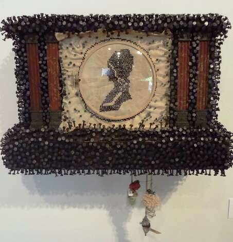 "Time -- as in ""at what time and under what circumstances?"" -- is an underlying theme in the work of San Marcos artist Mary Mikel Stump, incluiding this assemblage using an antique clock called ""What Time and Circumstance."""