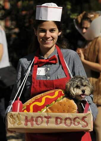 Stacey Surman and Butter work the concessions at the Tompkins Square Halloween Dog Parade. Photo: Timothy A. Clary, AFP/Getty Images
