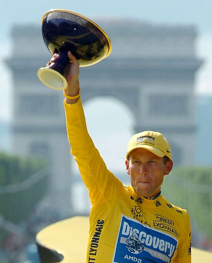In this July 24, 2005, file photo, Lance Armstrong holds the winner's trophy after claiming his seventh straight Tour de France cycling race during ceremonies on the Champs-Elysees avenue in Paris after the 21st and final stage of the race between Corbeil-Essonnes, south of Paris, and the French capital.  UCI, the cycling governing body, agreed Monday, Oct. 22, 2012 to strip Lance Armstrong of his seven Tour de France titles. Photo: Bernard Papon, Associated Press