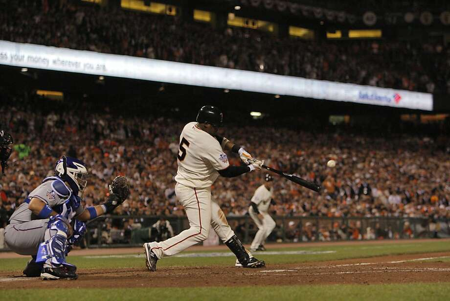 Giants Juan Uribe connects for a 3-run home run in the fifth inning as the San Francisco Giants take on the Texas Rangers in Game 1 of the World Series at AT&T Park in San Francisco, Calif., on Wednesday, October 27, 2010. Photo: Carlos Avila Gonzalez, San Francisco Chronicle