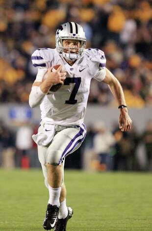 Kansas State quarterback Collin Klein runs with the ball during an NCAA college football game against West Virginia in Morgantown, W.Va., Saturday, Oct. 20, 2012. Kansas State won 55-14. (AP Photo/Christopher Jackson) Photo: Christopher Jackson, Associated Press / FRE170573 AP