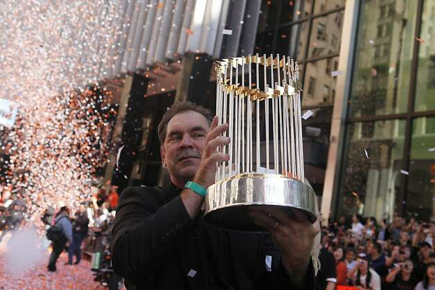 After the San Francisco Giants won the World Series, Giants manager Bruce Bochy, holds the World Series Championship trophy as he comes down Montgomery Street during the victory parade on Wednesday Nov. 03, 2010 in San Francisco, Calif. Photo: Mike Kepka, The Chronicle