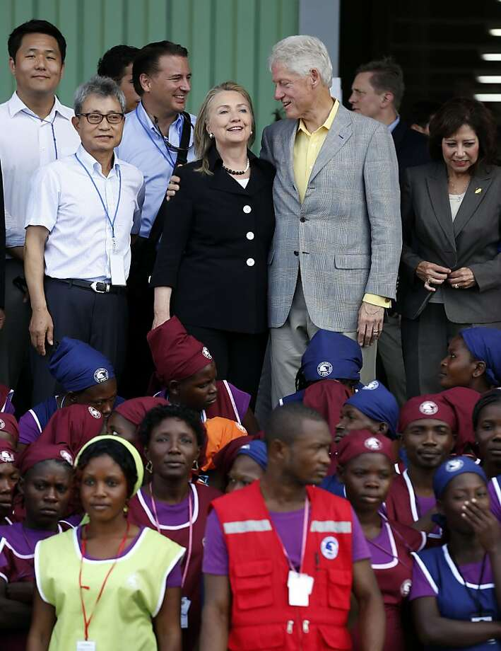 Secretary of State Hillary Rodham Clinton and ex-President Bill Clinton go to an industrial park opening in Caracol, Haiti. Photo: Larry Downing, Associated Press