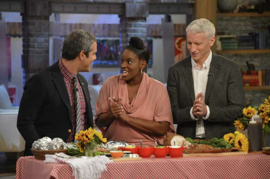 "Andy Cohen, left, Candace Brooks and Anderson Cooper prepare Harlon's Bar-B-Que Baked Potatoes on ""Anderson Live."" Photo: Anderson Live"