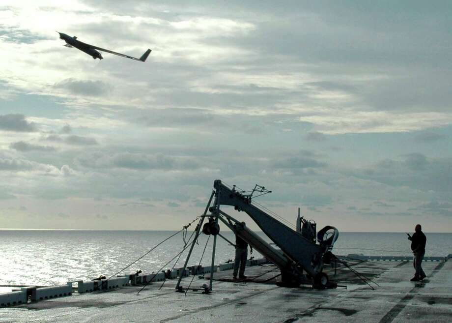 In this handout provided by the U.S. Navy, a Scan Eagle unmanned aerial vehicle launches from the flight deck of the amphibious assault ship USS Saipan on August 18, 2006 in the Atlantic Ocean. Photo: U.S. Navy, Getty Images / 2009 U.S. Navy