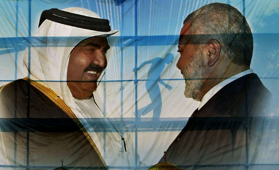 A Palestinian worker walks behind posters of the Emir of Qatar Sheikh Hamad bin Khalifa al-Thani, left, and Gaza's Hamas Prime Minister Ismail Haniyeh, right, in preparation for the upcoming visit to Gaza at Palestine stadium in Gaza City, Monday, Oct. 22, 2012. (AP Photo/Adel Hana) Photo: Adel Hana, Associated Press