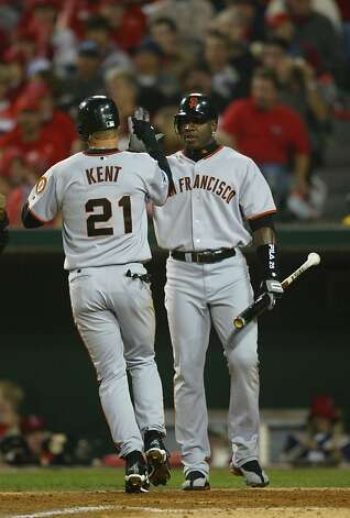 Jeff Kent is met by Barry Bonds after his third-inning home run in Game 2. Bonds and Kent combined for 16 hits, including seven HRs, in the Series. Photo: Michael Macor, SFC