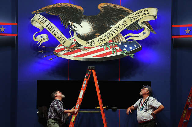BOCA RATON, FL - OCTOBER 21:  Workers put the finishing touches on the stage for the final presidential debate that will take place at Lynn University on Monday between U.S. President Barack Obama and Republican presidential candidate Mitt Romney October 21, 2012 in Boca Raton, Florida. The debate will mark the final meeting between the two candidates before the general election on November 6th.  (Photo by Joe Raedle/Getty Images) Photo: Joe Raedle, Getty Images / 2012 Getty Images