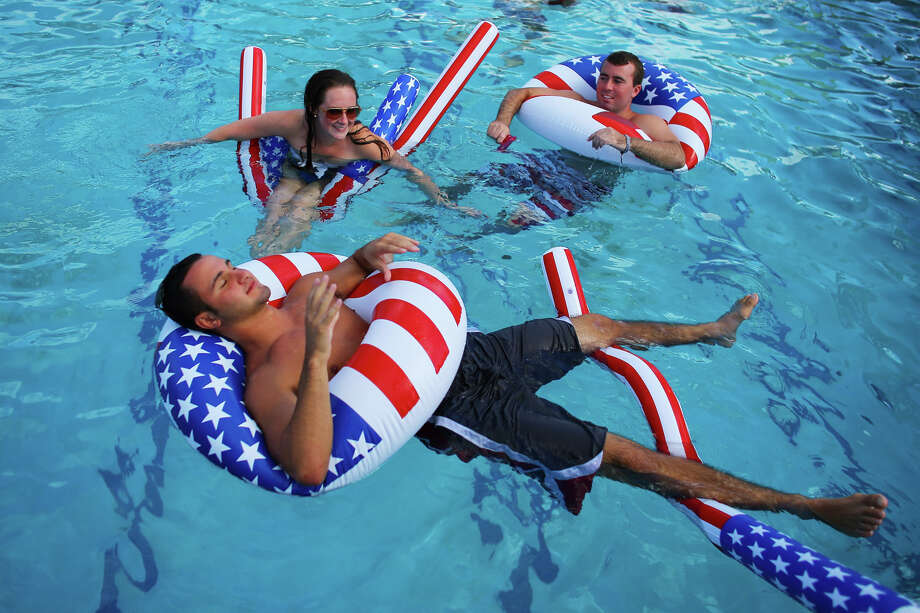 BOCA RATON, FL - OCTOBER 22:  Matt Alleva (front) along with other students play in the campus pool prior to the debate between U.S. President Barack Obama and Republican presidential candidate Mitt Romney at Lynn University on October 22, 2012 in Boca Raton, Florida. The focus for the final presidential debate before Election Day on November 6 is foreign policy.  (Photo by Joe Raedle/Getty Images) Photo: Joe Raedle, Getty Images / 2012 Getty Images