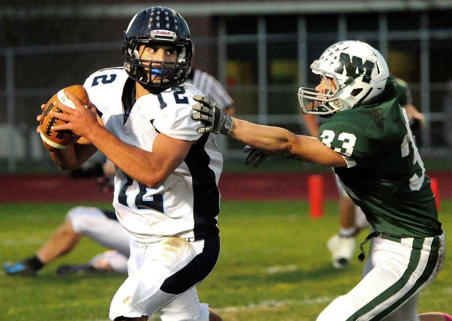 Rich Kovacs avoids Nick Capriglione's tackle as Oxford plays football at New Milford Monday, Oct. 22, 2012. Photo: Michael Duffy / The News-Times