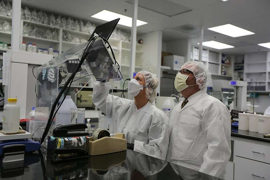 Charles Leiter (right), co-owner of Leiter's Compounding Pharmacy in San Jose, works alongside compounding technician Teresa Budetti. Photo: Rashad Sisemore, The Chronicle