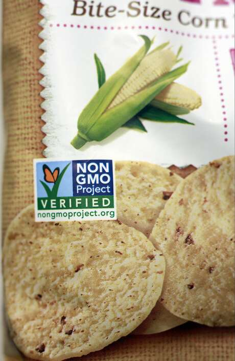 Corn chips display a voluntary Non GMO Project Verified label. A bill in the Senate would ban states from passing mandatory labeling laws for genetically modified organisms.  Photo: Damian Dovarganes, Associated Press