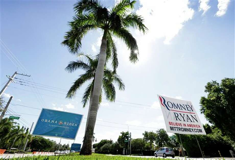 Campaign igns are seen in a median in front of Lynn University, site of Monday's presidential debate between President Barack Obama and Republican presidential candidate, former Massachusetts Gov. Mitt Romney, Sunday, Oct. 21, 2012, in Boca Raton, Fla. (AP Photo/Charlie Neibergall) Photo: Charlie Neibergall, ASSOCIATED PRESS / AP2012