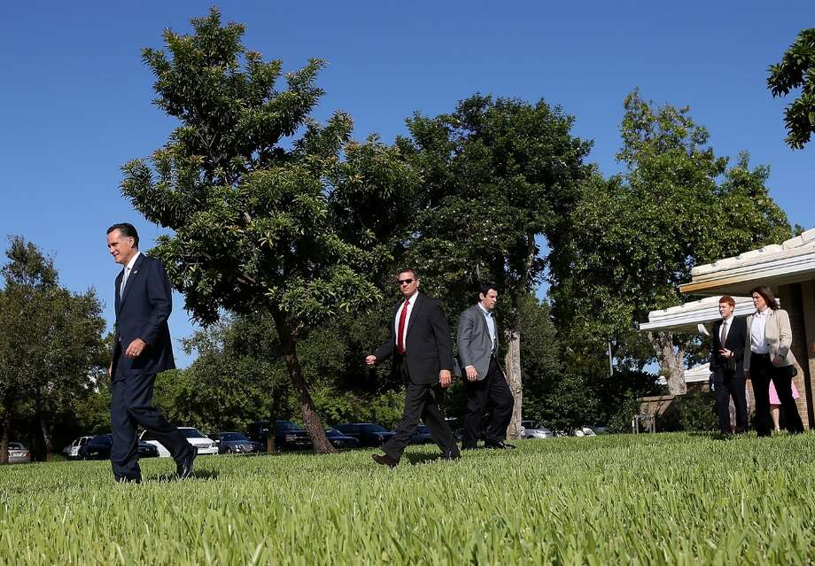 BOCA RATON, FL - OCTOBER 21:  Republican presidential candidate, former Massachusetts Gov. Mitt Romney (L) leaves church services at the Church Of Jesus Christ Of Latter Day Saints on October 21, 2012 in Boca Raton, Florida. Mitt Romney attended church services a day before the third and final presidential debate with U.S. President Barack Obama.  (Photo by Justin Sullivan/Getty Images) Photo: Justin Sullivan, Getty Images / 2012 Getty Images