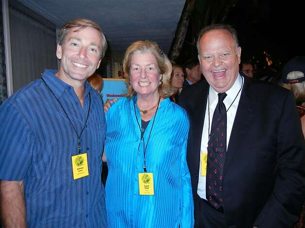 "Johnny ""Love"" Metheny (left) with event co-chair Laura Pfaff and Harry ""Mr. Nightlife"" Denton during the Pool Toss at the Phoenix Hotel. Photo: Catherine Bigelow, Special To The Chronicle"