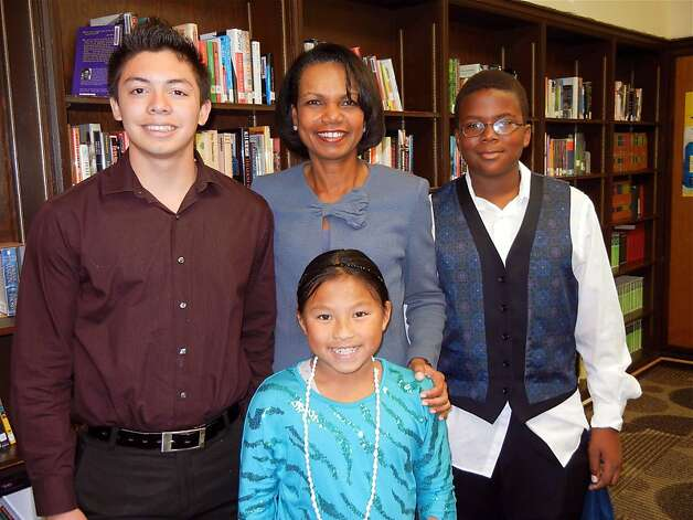 Condoleezza Rice with Gateway students Omar Alonzo (left), Kayla Lee and Selascie Smith at the public charter schools' 10th anniversary luncheon. Photo: Catherine Bigelow, Special To The Chronicle
