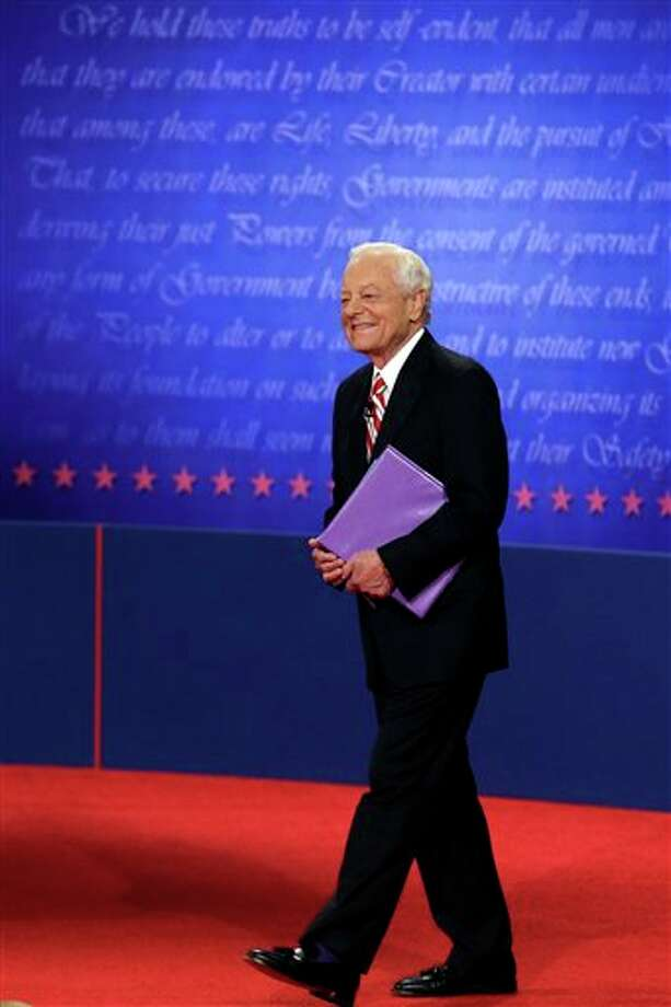 Moderator Bob Schieffer walks on stage before the third presidential debate at Lynn University, Monday, Oct. 22, 2012, in Boca Raton, Fla. (AP Photo/Charlie Neibergall) Photo: Charlie Neibergall, AP / AP
