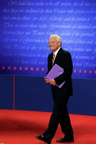 Moderator Bob Schieffer walks on stage before the third presidential debate at Lynn University, Mond