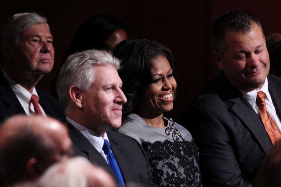 BOCA RATON, FL - OCTOBER 22:  First lady Michelle Obama, Robert Wexler (L) and Scott Van Duzer (R) owner of Big Apple Pizza in Fort Pierce, FL attend the debate between U.S. President Barack Obama and Republican presidential candidate Mitt Romney at the Keith C. and Elaine Johnson Wold Performing Arts Center at Lynn University on October 22, 2012 in Boca Raton, Florida. The focus for the final presidential debate before Election Day on November 6 is foreign policy.  (Photo by Marc Serota/Getty Images) Photo: Marc Serota, Getty Images / 2012 Getty Images