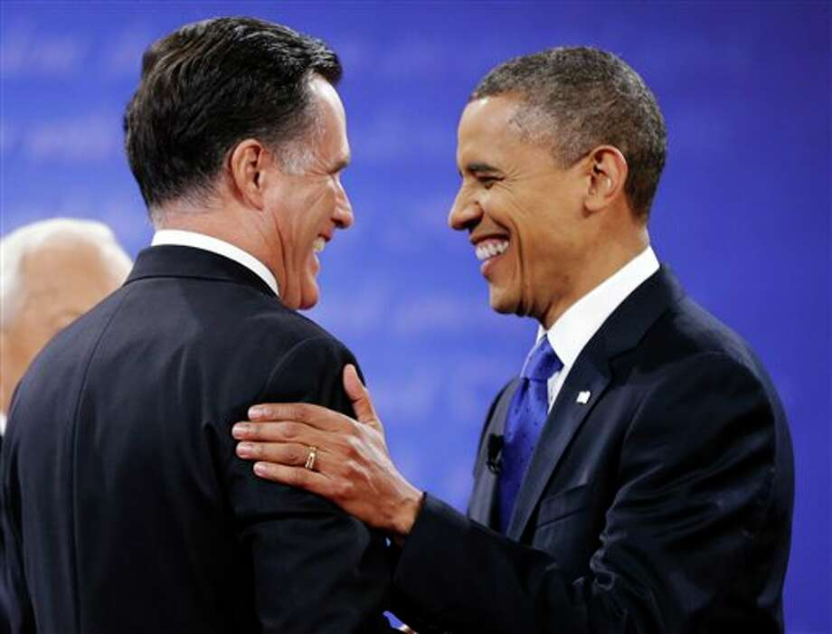 Republican presidential nominee Mitt Romney, left is greeted by President Barack Obama before the start of the third presidential debate at Lynn University, Monday, Oct. 22, 2012, in Boca Raton, Fla. (AP Photo/David Goldman) Photo: David Goldman, ASSOCIATED PRESS / AP2010