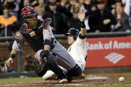 San Francisco Giants' Buster Posey scores past St. Louis Cardinals catcher Yadier Molina during the third inning of Game 7 of baseball's National League championship series Monday, Oct. 22, 2012, in San Francisco. Posey scored from first on a double by Hunter Pence. (AP Photo/David J. Phillip)