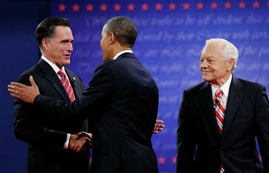 Moderator Bob Schieffer, right, watches as President Barack Obama, center, shakes hands with Republican presidential nominee Mitt Romney during the third presidential debate at Lynn University, Monday, Oct. 22, 2012, in Boca Raton, Fla. (AP Photo/Eric Gay) Photo: Eric Gay, AP / AP