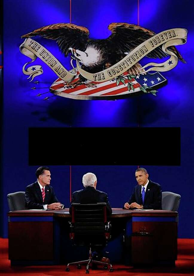 President Barack Obama answers a question as Republican presidential nominee Mitt Romney listens during the third presidential debate at Lynn University, Monday, Oct. 22, 2012, in Boca Raton, Fla. (AP Photo/Charlie Neibergall) Photo: Charlie Neibergall, AP / AP