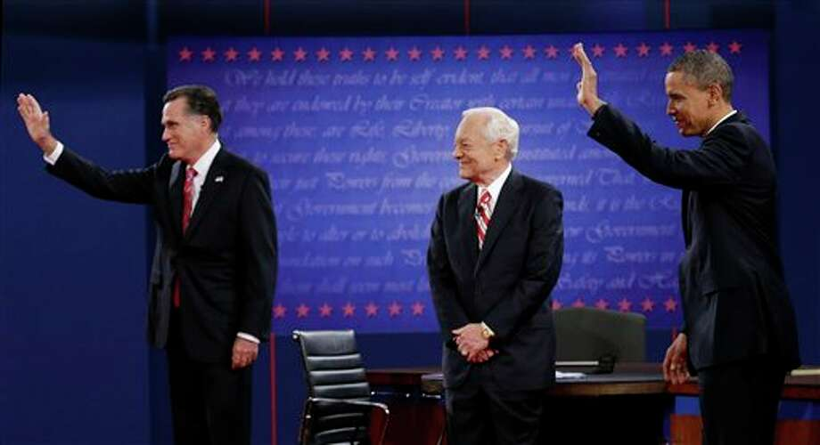 Moderator Bob Schieffer, center, watches as Republican presidential nominee Mitt Romney, left and President Barack Obama  wave to members of the audience during the third presidential debate at Lynn University, Monday, Oct. 22, 2012, in Boca Raton, Fla. (AP Photo/Eric Gay) Photo: Eric Gay, AP / AP