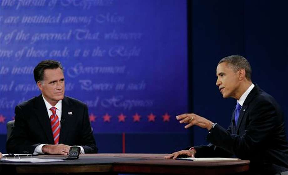 Republican presidential nominee Mitt Romney, left, listens to President Barack Obama during the third presidential debate at Lynn University, Monday, Oct. 22, 2012, in Boca Raton, Fla. (AP Photo/Eric Gay) Photo: Eric Gay, ASSOCIATED PRESS / AP2010