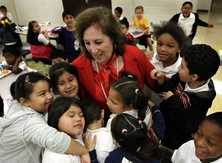 "Students swarm Elida Troutman as she enters the lunchroom at Crockett Elementary School. The retiring principal, who spent  more than three decades at the school, paved the way for Crockett being rated ""exemplary"" and becoming a fine arts magnet. Photo: J. Patric Schneider / © 2012 Houston Chronicle"