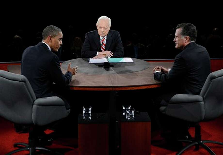 President Barack Obama speaks as Republican presidential nominee Mitt Romney and moderator Bob Schieffer listen during the third presidential debate at Lynn University, Monday, Oct. 22, 2012, in Boca Raton, Fla. (AP Photo/Pool-Michael Reynolds) Photo: Michael Reynolds, AP / EPA Pool