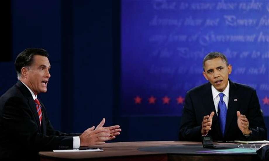 Republican presidential nominee Mitt Romney, left, and President Barack Obama make their points to moderator Bob Schieffer during the third presidential debate at Lynn University, Monday, Oct. 22, 2012, in Boca Raton, Fla. (AP Photo/David Goldman) Photo: David Goldman, AP / AP