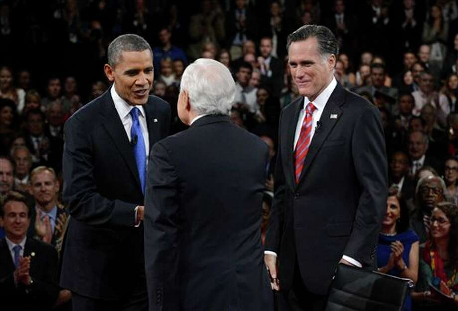 President Barack Obama is greeted by moderator Bob Schieffer, center, as Republican presidential nominee Mitt Romney stands nearby at the start of the third presidential debate at Lynn University, Monday, Oct. 22, 2012, in Boca Raton, Fla. (AP Photo/Pool-Michael Reynolds) Photo: Michael Reynolds, AP / EPA Pool