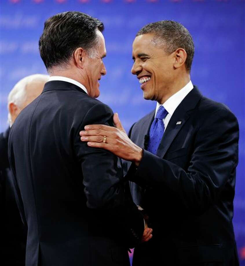 President Barack Obama, right, greets Republican presidential nominee Mitt Romney at the start of the third presidential debate at Lynn University, Monday, Oct. 22, 2012, in Boca Raton, Fla. (AP Photo/David Goldman) Photo: David Goldman, AP / AP