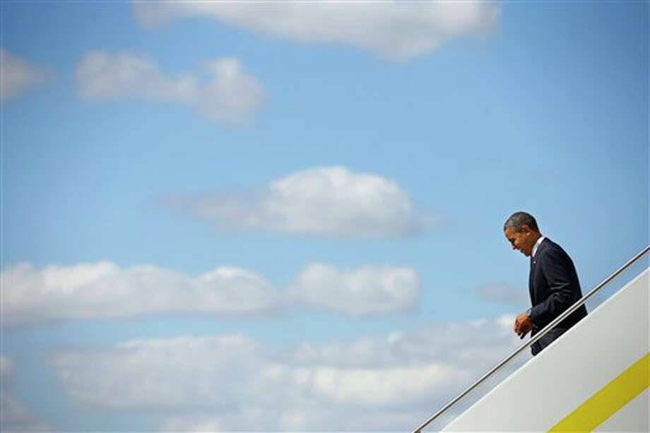 President Barack Obama walks down the stairs upon his arrival on Air Force One at Palm Beach International Airport in West Palm Beach, Fla., Monday, Oct. 22, 2012. Obama traveled to Florida for the last presidential debate, in Boca Raton, Fla., against Republican presidential candidate, former Massachusetts Gov. Mitt Romney. (AP Photo/Pablo Martinez Monsivais) Photo: Pablo Martinez Monsivais, AP / AP