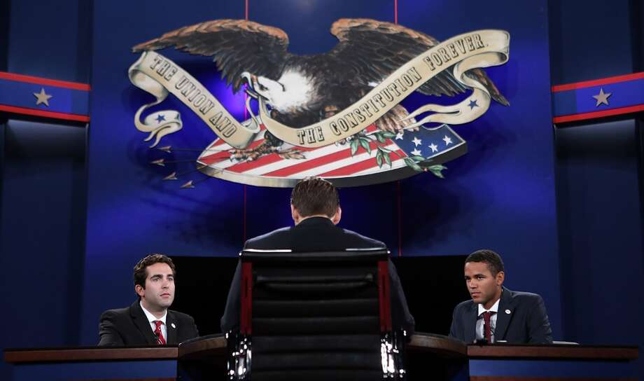 BOCA RATON, FL - OCTOBER 21:  Stand-ins for Republican presidential candidate Mitt Romney, moderator Bob Scheiffer, and U.S. President Barack Obama participate in a stage rehearsal a day ahead of the final presidential debate at Lynn University October 21, 2012 in Boca Raton, Florida. The U.S. election is a little over two weeks away. From left to right are Lynn University students A.J. Mercincavage, Andrew Lippi, and Eric Gooden. (Photo by Win McNamee/Getty Images) Photo: Win McNamee, Getty Images / 2012 Getty Images